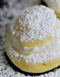 Powdered Cream Puffs make a beautiful, delicious treat to serve as a dessert or afternoon sweet little nibble with a glass of milk, a warm mug of hot chocolate or a cup of coffee. // addapinch.com