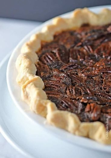 The BEST Pecan Pie Recipe - The BEST Pecan Pie Recipe - This Pecan Pie Recipe is a classic in my husband's family. For every family gathering, you better believe there will be pecan pie sitting front and center on the dessert table. Every. single. time. // addapinch.com