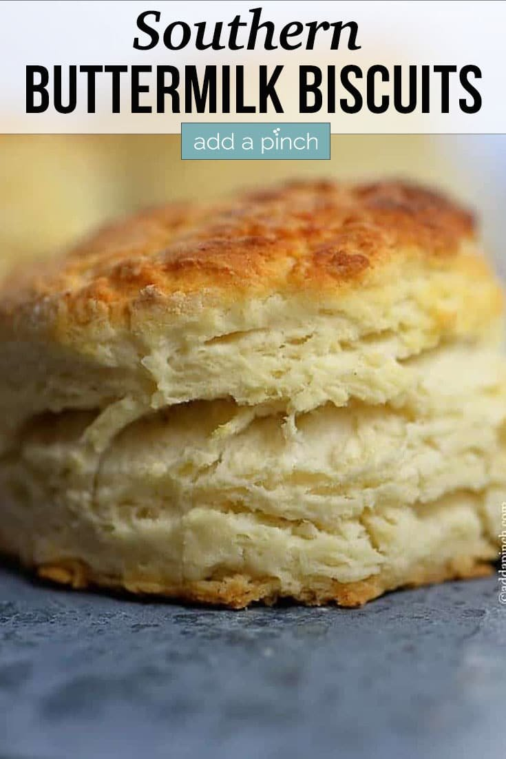 Golden Buttermilk Biscuit with layers - with text - addapinch.com