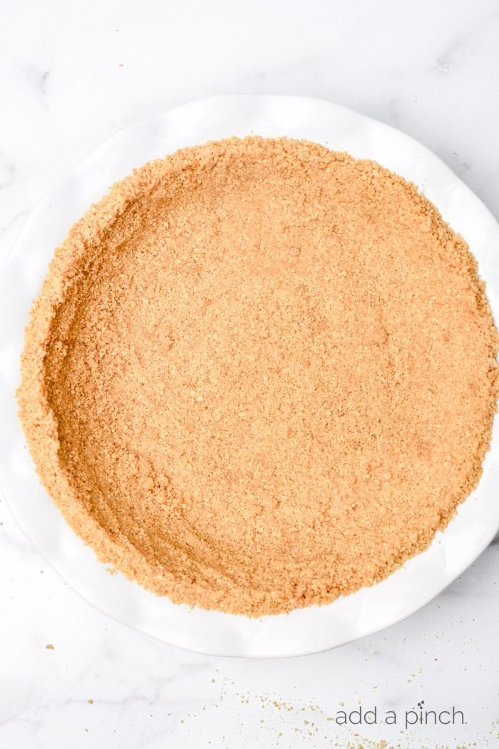 A simple graham cracker crust is perfect for so many recipes. From key lime pie to a chocolate tart, a graham cracker crust is a never fail favorite. // addapinch.com