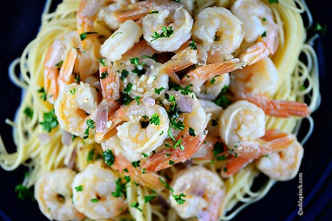 Shrimp Scamp Recipe – This easy shrimp scampi is made of shrimp sautéed in butter and olive oil, garlic, and tossed with pasta. // addapinch.com