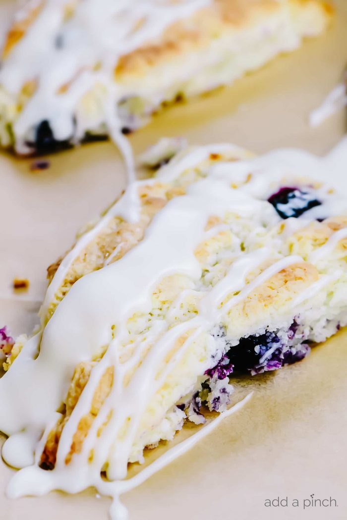 Lemon Blueberry Scones Recipe - Scones make a delicious treat for breakfast, brunch or an afternoon treat. These lemon blueberry scones are full of flavor while being light and moist. // addapinch.com
