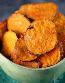 Sweet Potato Chips - Sweet Potato Chips make a delicious snack or crunchy side dish. Made with just three ingredients, these healthy sweet potato chips are ready in 5 minutes! // addapinch.com