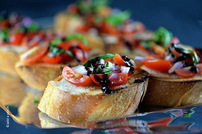 Bruschetta makes a delicious, quick and easy dish. Made of tomatoes, onions, garlic, basil and olive oil on grilled bread. Ready in less than 15 minutes! // addapinch.com