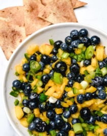 Blueberry Peach Salsa makes a delicious fruit salsa. Made of blueberries, peaches and a few other simple ingredients, this blueberry peach salsa is a summertime favorite. // addapinch.com