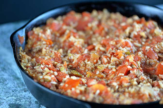 Spanish Rice Recipe - This Spanish Rice recipe is made with ground beef for a main dish meal! Ready in less than 30 minutes! // addapinch.com