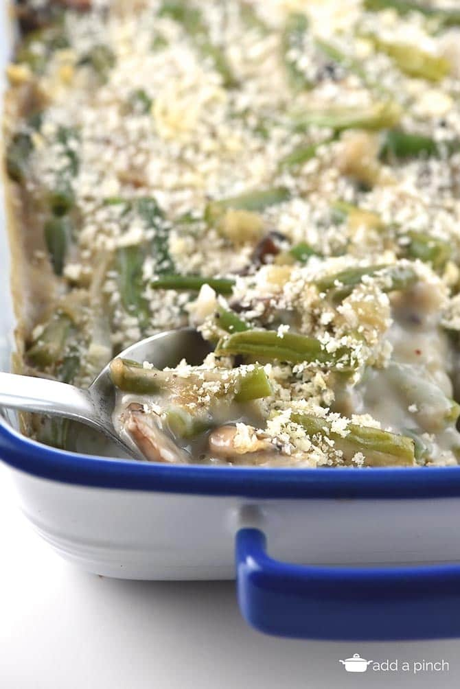 This Easy Green Bean Casserole is a fresh take on classic family recipe!  It's the easiest, creamiest and most delicious green bean casserole recipe ever. Made even more delicious with homemade cream of chicken! // addapinch.com