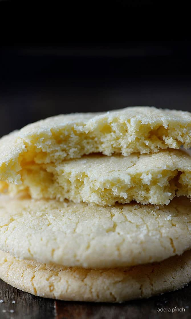 Absolutely the BEST sugar cookie recipe I've ever tasted! These sugar cookies are soft, chewy and produce a flavorful bakery style soft sugar cookie! Quick and easy to make, this sugar cookie recipe makes cookies that turn out perfectly every single time! // addapinch.com
