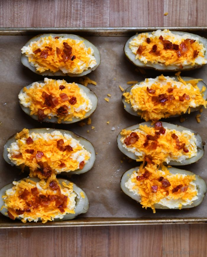 Twice Baked Potatoes Recipe - These potatoes make any meal an event! They take baked potatoes to a whole new level of creamy, cheesy, buttery deliciousness. Easy enough to make ahead in stages, twice baked potatoes make an elegant side dish when entertaining! // addapinch.com