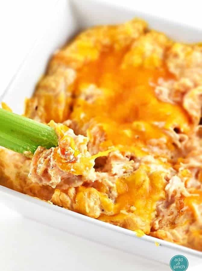 Buffalo Chicken Dip tastes just like the buffalo chicken we all love. This creamy buffalo chicken dip comes together easily and is always a winner! // addapinch.com