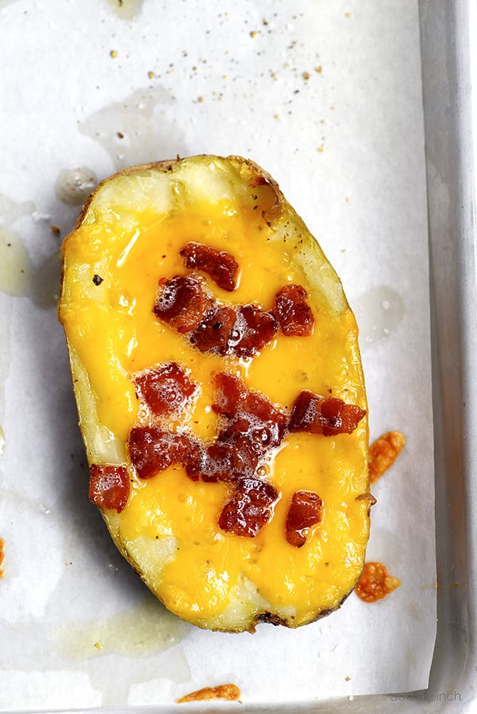 Homemade Potato Skins Recipe - Potato skins make an easy and delicious recipe perfect for parties or game day! // addapinch.com