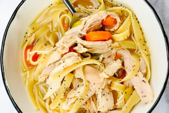 Instant Pot Chicken Noodle Soup Recipe - A classic chicken noodle soup recipe updated using the Instant Pot! This incredible homemade chicken noodle soup is loaded with fresh vegetables, tender chicken for a comforting, delicious soup! // addapinch.com