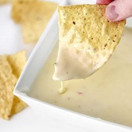 Queso dip makes a delicious appetizer. Made with a special combination of cheeses and ready in 5 minutes, this queso will be a favorite!  // addapinch.com