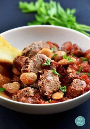 Slow Cooker Peppercorn Garlic Pork Cassoulet from addapinch.com
