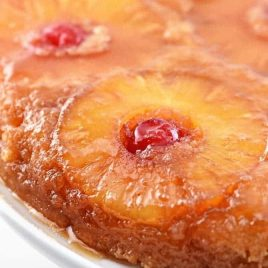 Pineapple Upside Down Cake makes a timeless dessert. Topped with a signature pineapple and cherry topping, this pineapple upside down cake is a southern classic. // addapinch.com