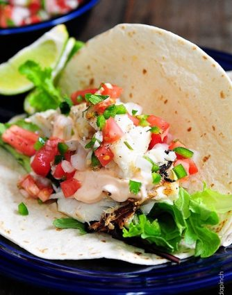 Fish Tacos Recipe - These fish tacos are so quick and easy and perfect for serving for a family supper or when entertaining! Made of flaky white fish, these fish tacos are a definite favorite!