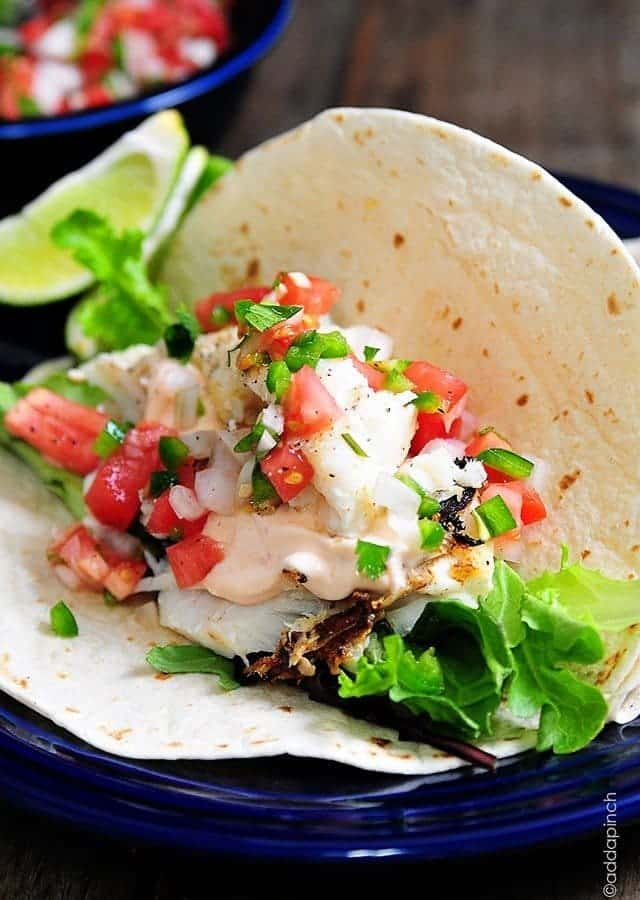 These fish tacos are so quick and easy and perfect for serving for a family supper or when entertaining! Made of flaky white fish, these fish tacos are a definite favorite!