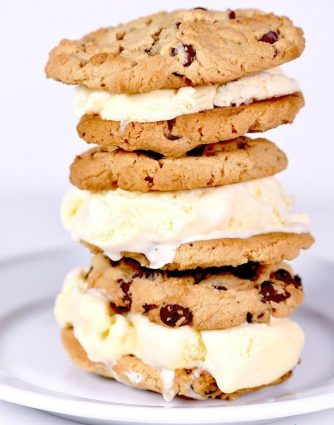 Ice cream sandwiches make a favorite sweet treat! This peanut butter ice cream sandwich is one that the whole family loves! // addapinch.com