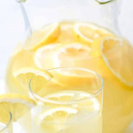 Lemonade Recipe - Refreshing homemade Fresh Lemonade recipe made with fresh lemons! It's a classic delicious drink perfect for any occasion! Makes the perfect cold drink and is such a family favorite! // addapinch.com