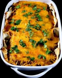 This easy beef and bean enchilada recipe comes together quickly for a delicious recipe perfect for a weeknight supper! // addapinch.com