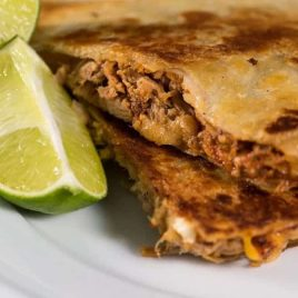 Pulled pork quesadillas make an all-time favorite leftover makeover the whole family loves! So simple and easy! // addapinch.com