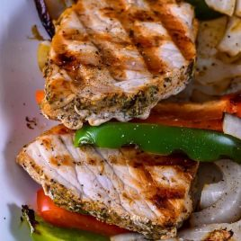 Grilled Pork Loin with Peppers and Onions makes a quick and easy dish perfect for weeknight or weekend meals! // addapinch.com
