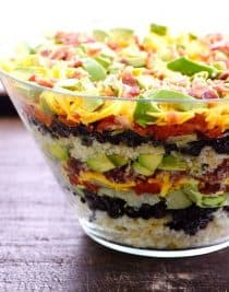 Mexican Cornbread Salad makes a delicious layered salad recipe using spicy Mexican cornbread, beans, tomatoes, and so much more! // addapinch.com