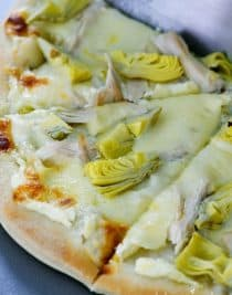 Chicken Artichoke Pizza made with homemade pizza crust, cheese, chicken and artichoke hearts makes a pizza recipe everyone loves! // addapinch.com
