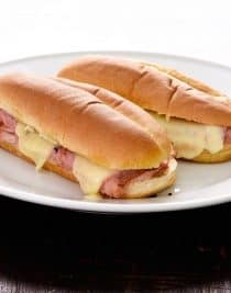 Hot Ham and Cheese Sandwiches Recipe -These simple ham sandwiches are perfect for a quick lunch or supper. Made of ham, cheese, spices, olive oil and vinegar, this isn't just any ham sandwich! // addapinch.com