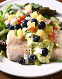 Baked Mahi Mahi with Pineapple Blueberry Salsa makes a delicious, quick and easy meal perfect for a weeknight supper or entertaining! // addapinch.com