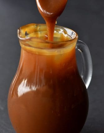 Salted Caramel Sauce Recipe - The absolute best salted caramel sauce recipe that I have ever tasted! Smooth, creamy and perfect every single time! // addapinch.com