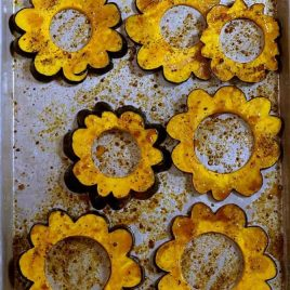 Maple Roasted Acorn Squash Recipe - Maple Roasted Acorn Squash makes a quick, delicious, and beautiful side dish. Made of acorn squash, maple syrup, and a sprinkling of spices. // addapinch.com