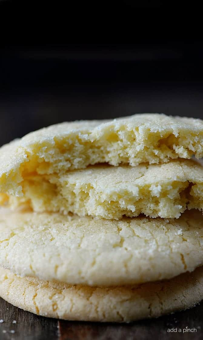 The BEST Chewy Sugar Cookies Recipe - Absolutely the BEST sugar cookie recipe I've ever tasted! These sugar cookies are soft, chewy and produce a flavorful bakery style soft sugar cookie! Quick and easy to make, this sugar cookie recipe makes cookies that turn out perfectly every single time! // addapinch.com
