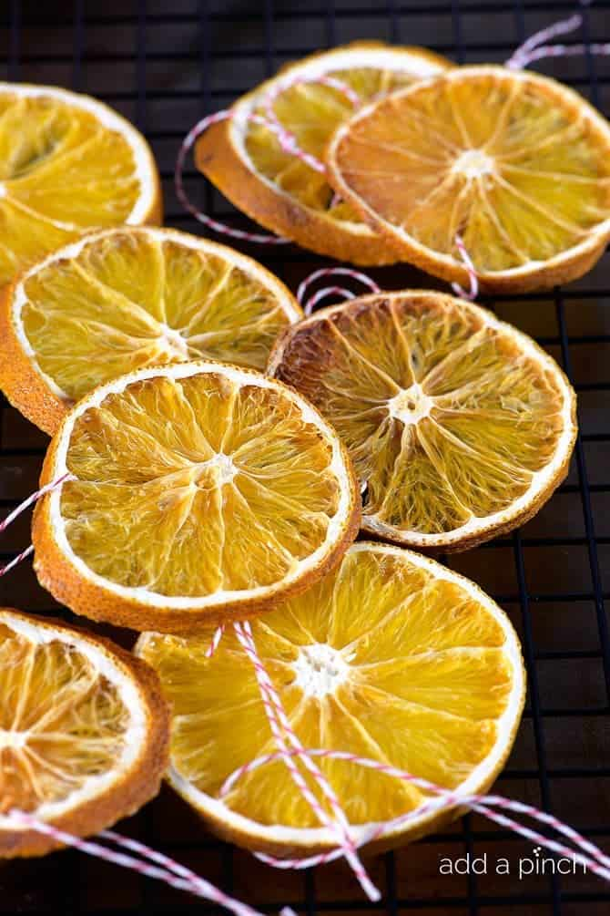 How to Make Dried Orange Slices - Dried Orange Slices make great additions to floral arrangements, wreaths and as Christmas ornaments. // addapinch.com