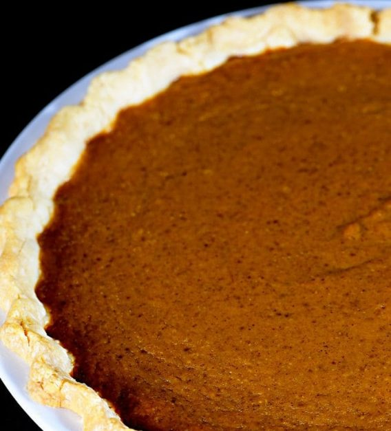 This classic pumpkin pie recipe makes an old fashioned pie perfect for serving during the holidays or anytime! So easy and delicious, this is a family-favorite pumpkin pie! // addapinch.com