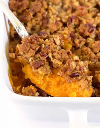 Sweet Potato Casserole is a southern classic. With a rich, buttery taste and crunchy topping, sweet potato casserole makes a perfect side dish or a dessert. // addapinch.com