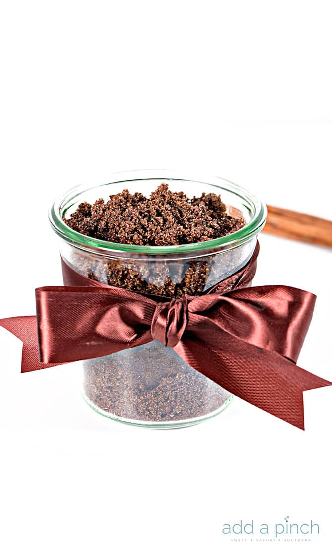 An easy, all-natural sugar scrub recipe featuring brown sugar and cinnamon that smells amazing! Brown Sugar Cinnamon Sugar Scrub is made of just four ingredients and ready in minutes! Great for gifts!! // addapinch.com