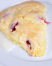 Cranberry Orange Scones make a quick and easy scone recipe perfect for breakfast or brunch. A delicious combination of sweet and tart! // addapinch.com