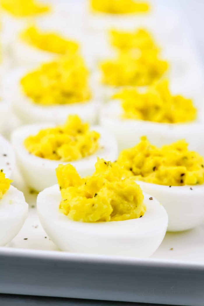 Deviled eggs make the perfect appetizer or side dish for family meals, parties, holidays, potlucks, picnics and more. This simple and classic deviled eggs recipe is a family favorite! // addapinch.com