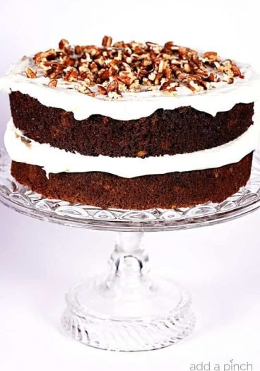 Favorite Carrot Cake Recipe - Carrot Cake makes for a flavorful and delicious dessert! Made with grated carrots and other mix-ins, this is my favorite carrot cake recipe of all time! // addapinch.com