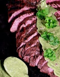 Grilled Flank Steak Recipe - Flank Steak is a long, relatively thin cut of beef that when cooked properly practically melts in your mouth! Served with a chimichurri sauce, this flank steak is a definite favorite! // addapinch.com