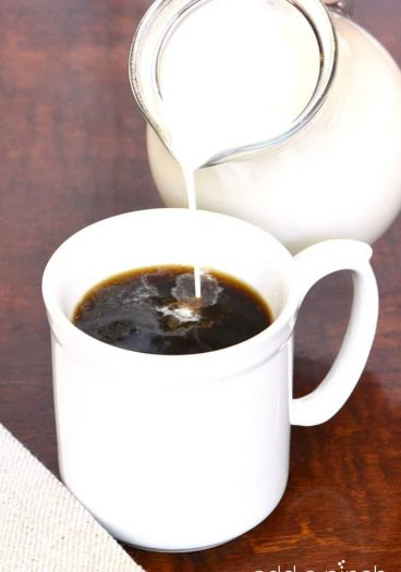 Homemade Coffee Creamer makes a quick, easy, and delicious treat for your coffee! Made with just four ingredients and ready in minutes! // addapinch.com