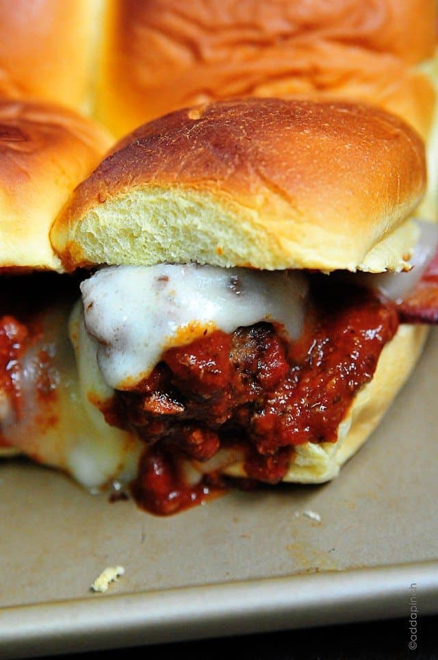 Meatball Sliders make a great appetizer, lunch or even supper! Just be sure to make plenty of these meatball sliders! // addapinch.com