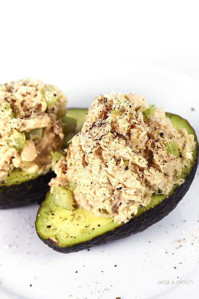 Tuna Salad Recipe - This Tuna Salad recipe makes a delicious, flavorful recipe perfect for lunch or a light supper! Stuffed into an avocado, as a sandwich or served on a lettuce leaf! // addapinch.com