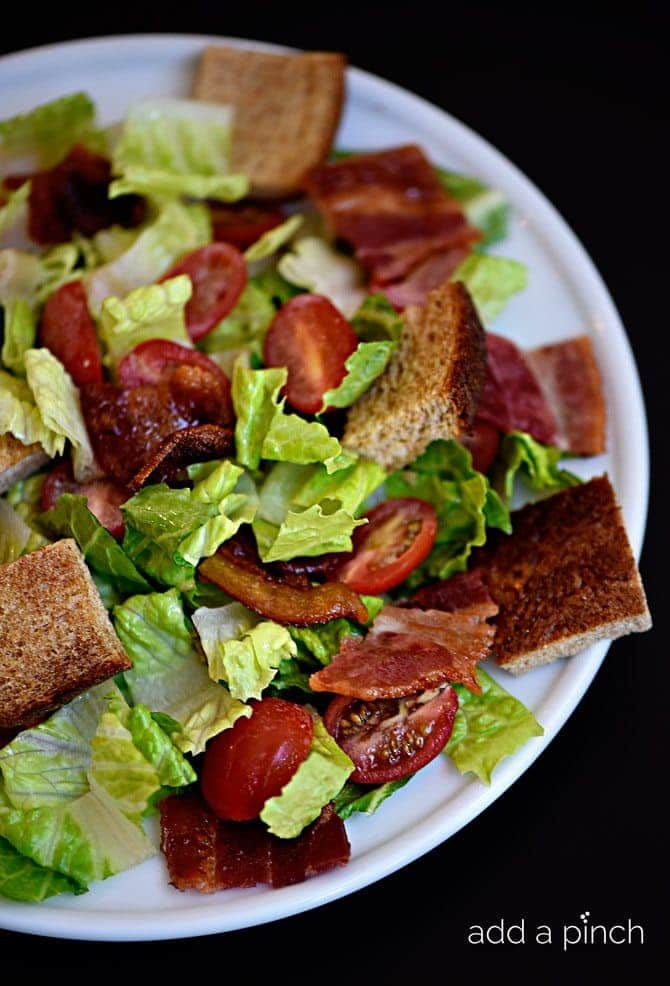 BLT Panzanella Salad Recipe - This BLT Panzanella Salad recipe comes together quickly for a delicious lunch or supper! Ready and on the table in minutes! // addapinch.com