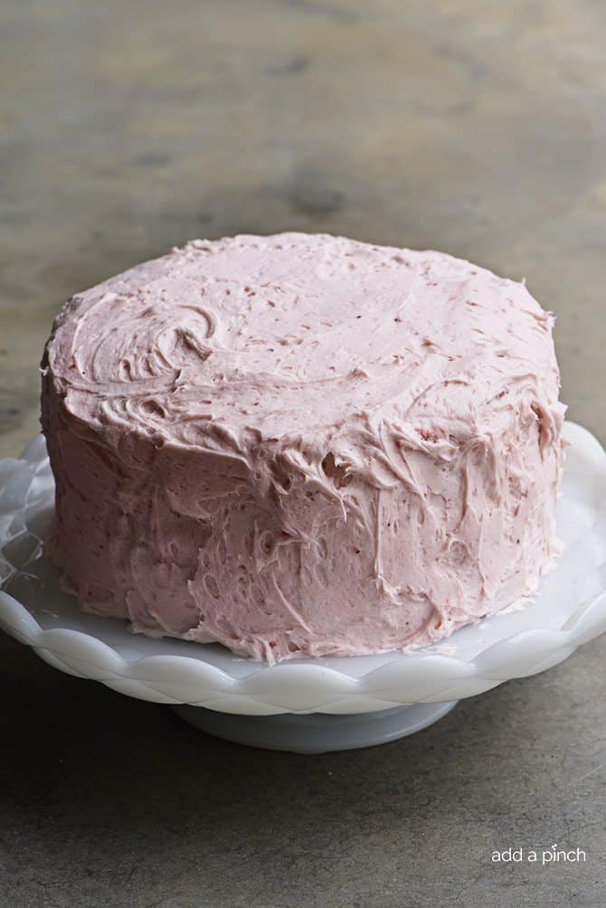 Strawberry Cake Recipe - Strawberry Cake made from scratch! This strawberry cake recipe is perfect for those looking for a homemade fresh strawberry cake. // addapinch.com