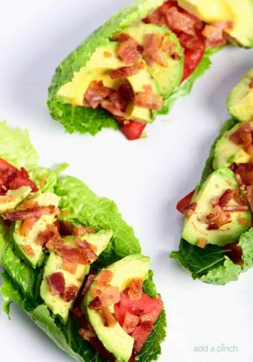 BLT Avocado Lettuce Wraps Recipe - BLT Avocado Lettuce Wraps make a quick, easy and delicious lunch or supper recipe! Perfect to lighten up the favorite BLT combo! // addapinch.com