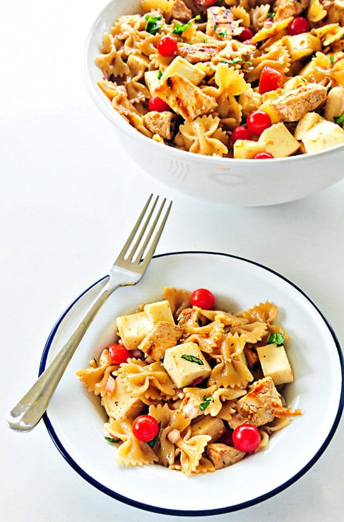 Chicken Caprese Pasta Recipe - this pasta salad recipe is delicious served hot or cold! // addapinch.com
