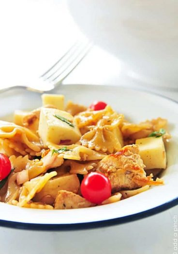 Chicken Caprese Pasta Salad Recipe - this pasta salad recipe is delicious served hot or cold! // addapinch.com