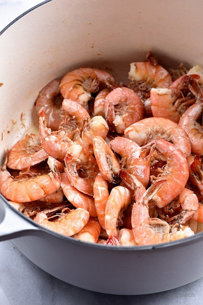 Stockpot of fresh shrimp after being boiled  // addapinch.com